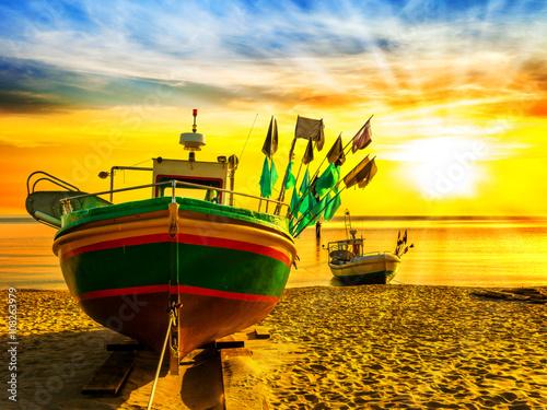 Papiers peints Jaune Fishing boats on beach at sunrise in Sopot, Poland.