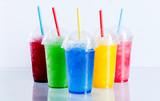 Fototapety Colorful Frozen Fruit Slush Drinks in Plastic Cups