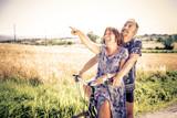 Senior couple cycling outdoors