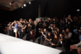 blurred image of group audience at fashion show stage