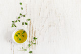 Sprigs of thyme and olive oil on a white Shabby background, spac - 108314139