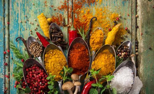 Zdjęcia na płótnie, fototapety na wymiar, obrazy na ścianę : Various colorful spices on wooden table