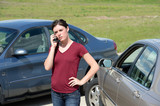 Woman Using Cellphone After Accident