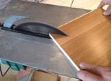 Taglio asse di parquet