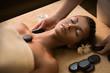 Quadro Beautiful girl has stone massage.