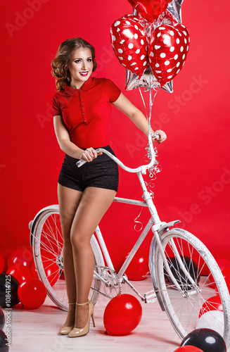 Poster Girl with bike and balloons