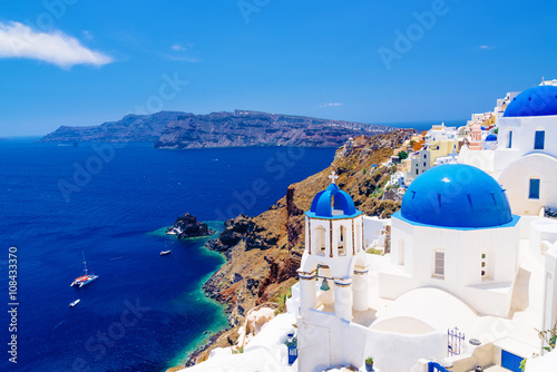 White architecture and churches with blue domes, Oia, Santorini, Greece © aetherial