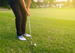 Golfer practicing chip and run
