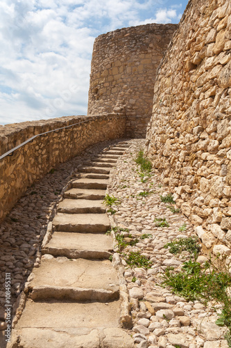 Fototapeta Old stone stairs go up to the ancient fortress