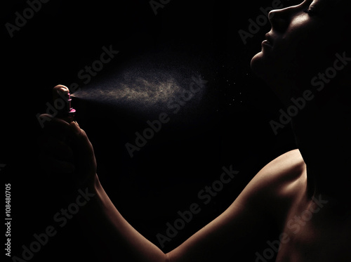 Poster Woman with perfume on black background