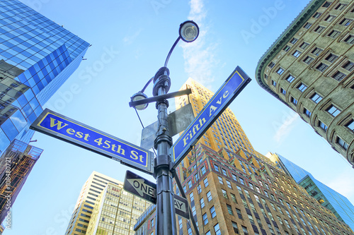 Road signs in Midtown Manhattan плакат