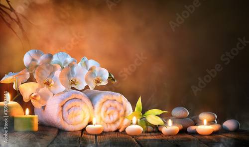 Spa - Couple Towels With Candles And Orchid For Natural Massage