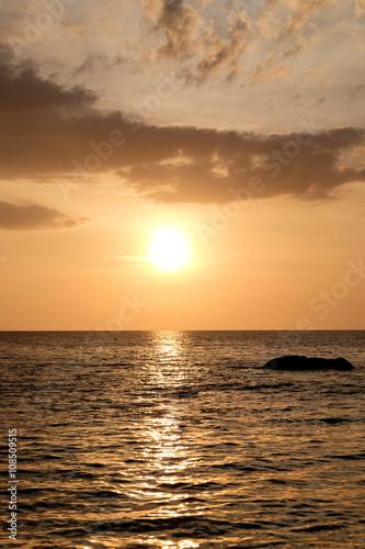 Foto op Canvas Zee zonsondergang Sunset on the beach