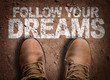 Top View of Boot on the trail with the text: Follow Your Dreams