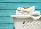 Fototapety White laundry basket with towels and pins