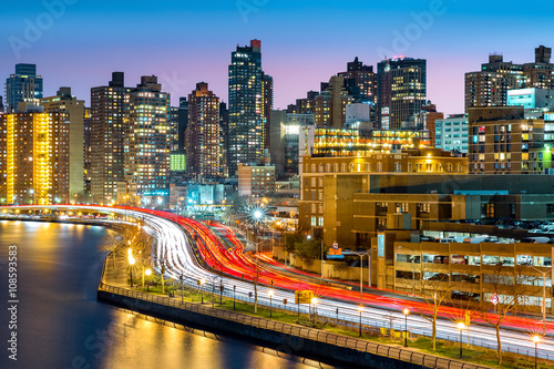 East Harlem neighborhood skyline with rush hour traffic on FDR drive, at dusk, in Manhattan, New York City
