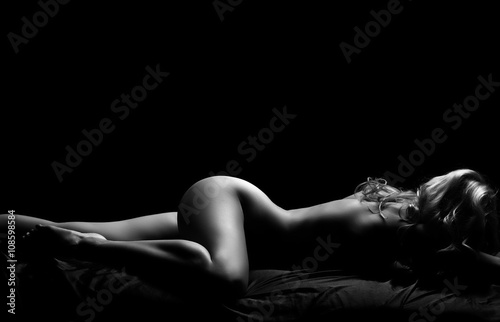 Black and white nude female portrait.