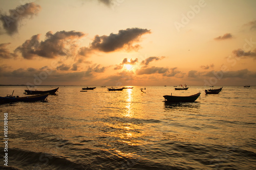 Foto op Canvas Zee zonsondergang Fishing boats, small boats floating in the sea at sunrise, Conce