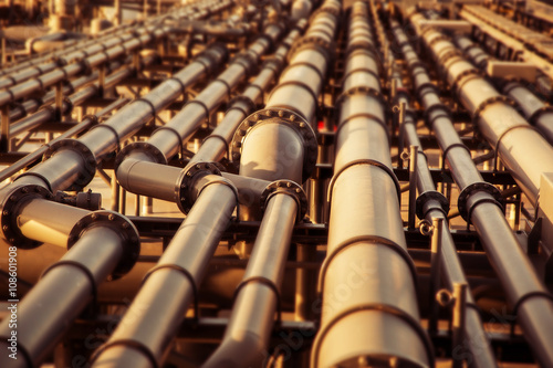 Oil pipeline colored blurred background. Poster