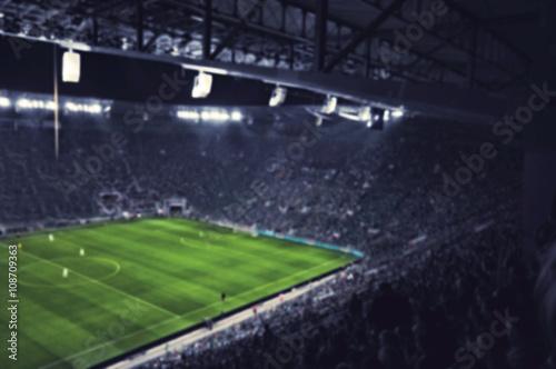 Poster blurred football stadium