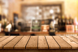 Fototapety wooden table with a view of blurred beverages bar backdrop