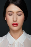 Young woman beauty with red lipstick and white shirt, eyes closed