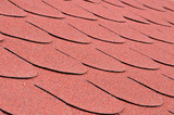 Red shingles on a roof in close up