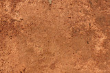 Fototapety Dry red soil and small rock in Thailand.