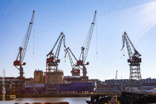 Harbor cranes in sea port of Helsinki, Finland.  © yegorov_nick