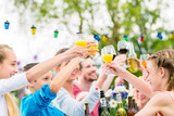 Friends and neighbors toasting on garden party - 108885799