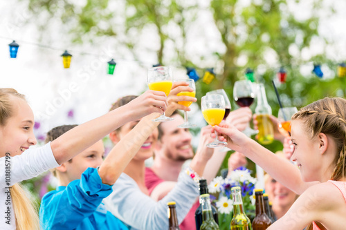 Zdjęcia na płótnie, fototapety, obrazy : Friends and neighbors toasting on garden party