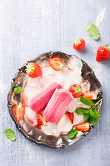 Homemade strawberry popsicles