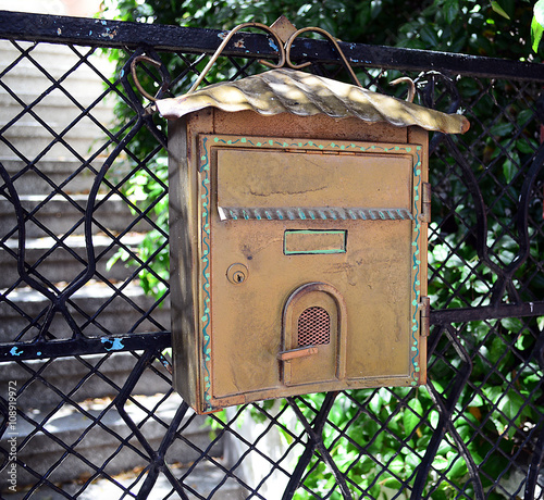 Old mailbox on fence background