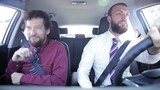 Happy business people dancing in car