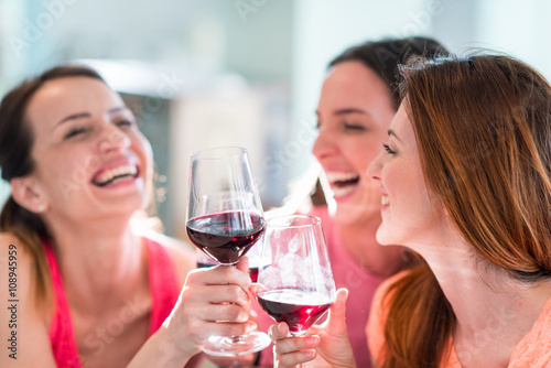 Friends drinking wine in restaurant, celebrating