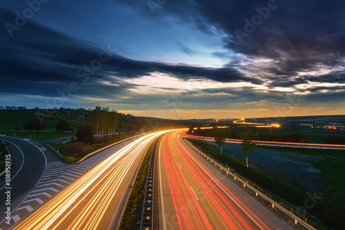 Long-exposure sunset over a highway - 108951935