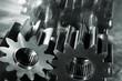 titanium cogwheels and gears mirrored in brushed aluminum