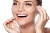 Fototapety Woman and dental floss