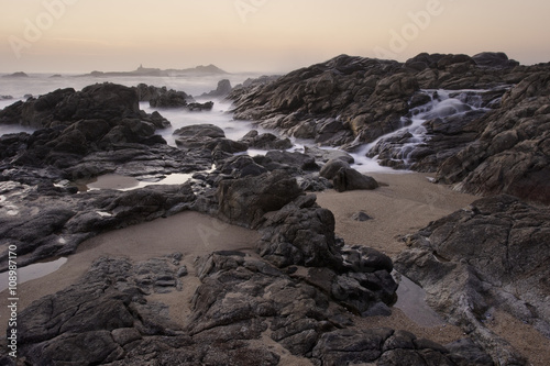 Rocky sea beach at sunset