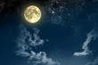 Beautiful magic blue night sky with clouds and fullmoon and stars