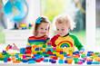 Leinwanddruck Bild - Kids playing with colorful plastic blocks