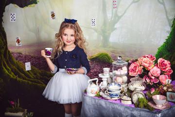 Beautiful little girl as Alice in Wonderland