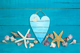 Heart sign with seashells border - 109003140