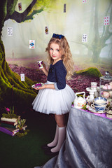 Cute little girl as Alice in Wonderland