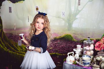 Beautiful blonde girl as Alice in Wonderland