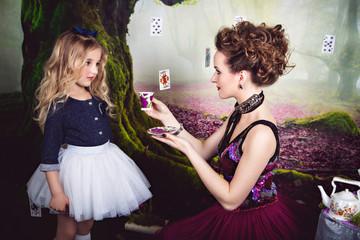 Evil Queen offers Alice a cup of tea
