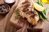 Fototapety Grilled chicken on a cutting board