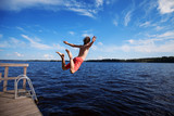Young man jumping into water - 109025732