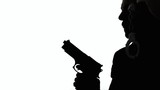 A man (cop, detective) checking the place with a gun and a pair of handcuffs. Silhouette shot.