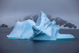 Beautifull blue iceberg and ocean. Peculiar landscape of the Antarctica